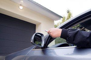Arm Pushing Garage Door Opener Button